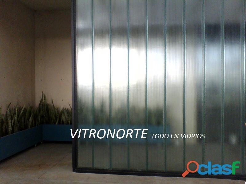 Paredes y fachadas en vidrio tipo Vitrolit uglass