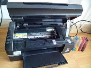Vendo impresora marca epson tx105 multifuncional sistema