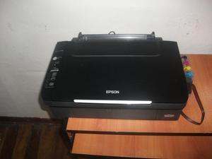 Vendo impresora multifuncional copia escanea e imprime marca