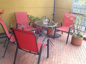 Combo mesa redonda base en vidrio parasol sillas rojas -