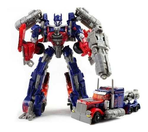Juguete accion robot transformers optimus + exhibidor