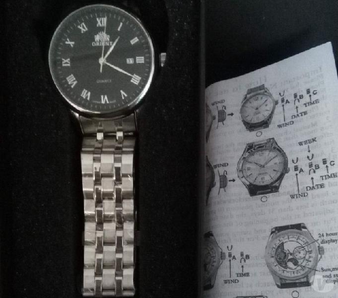 Vendo reloj orient de pila numeros romanos
