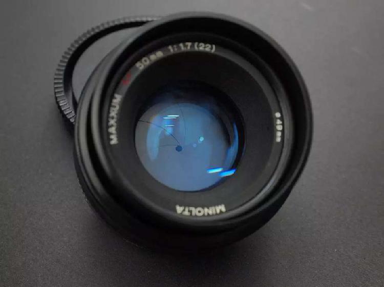 Lente minolta 50mm f 1.7 ver detalle acrilico