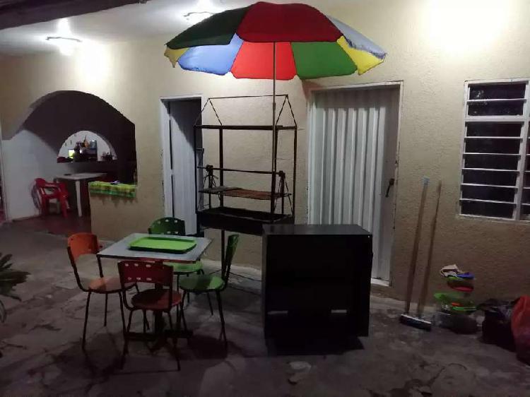 Mesas,sillas,asador,nevera.