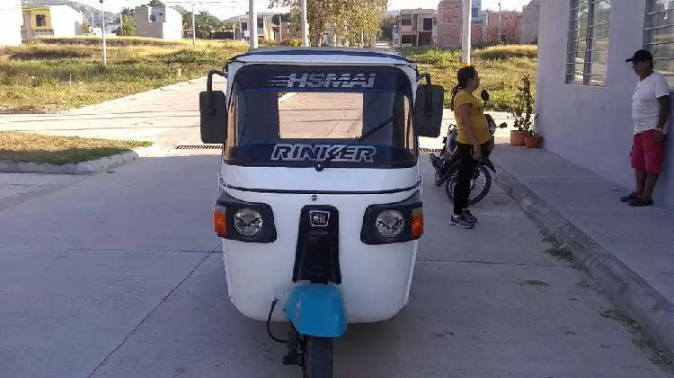 Mototaxi encarpado muy bueno de motor papeles de girardot