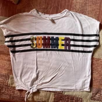 Camiseta blanca con diseño de ELV
