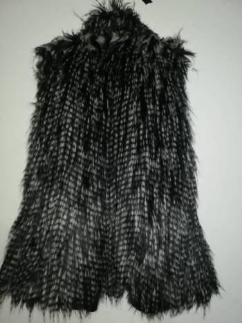 Chaleco plumas color gris juvenil