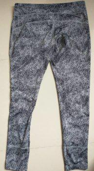 Pantalón deportivo gris punto blanco